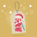 50 percent reduction Christmas sale label. With a red and white Xmas hat and a carnival mask with the word SALE vector illustration