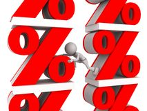 Percent signs. A view of large red percent signs and a small cartoon character Royalty Free Stock Photography