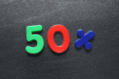 50 percent spelled out using colored fridge magnets Stock Photos
