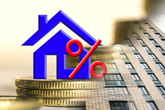 The percent symbol on the background of real estate and money . Stock Images