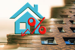 The percent symbol on the background of real estate and money . Stock Photo