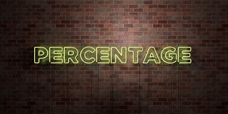 PERCENTAGE - fluorescent Neon tube Sign on brickwork - Front view - 3D rendered royalty free stock picture Stock Photos