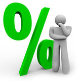 Percentage Sign - Thinking Man and Percent Symbol. A man is thinking in front of a green percentage symbol, representing the comparison between different Stock Photo