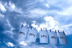 Percents in the sky. Sales in the blue sky Stock Image