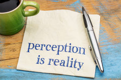 Perception is reality text on napkin Stock Image