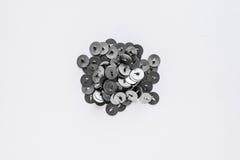 Percevejos do metal em um fundo branco Foto de Stock Royalty Free
