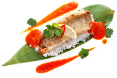 Perch fillets on bamboo leaves with rice and sauce Royalty Free Stock Photo