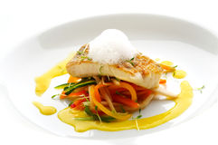 Perch fish fillet. With lemon cream and different vegetables royalty free stock image