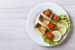 Perch fried fillet with vegetables. horizontal top view Royalty Free Stock Photography