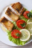 Perch fried fillet with vegetables. vertical top view Royalty Free Stock Photos