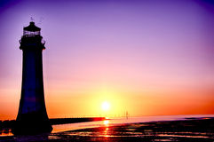 Perch Rock Lighthouse New Brighton Wirral England UK. Sunset at New Brighton - Slihouette of Perch rock Lighthouse royalty free stock image