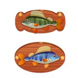 Perch on the wooden board Stock Photos