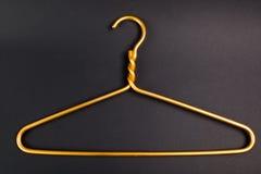 Percha amarilla Foto de archivo libre de regalías