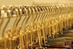 Perchas de oro Foto de archivo libre de regalías
