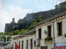 Perched castel of Gjirokaster in Albania seen by the lower part of the old city. stock photo