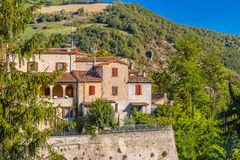 Perched houses on ancient fortified ramparts. Of a medieval village on the hills of Romagna royalty free stock photo