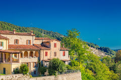 Perched houses on ancient fortified ramparts. Of a medieval village on the hills of Romagna stock photo