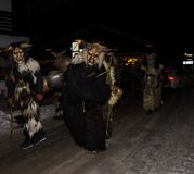 Perchten demons run in December. Locals dressed up as demons and scary monsters roam the streets to drive away the winter in a centruries old tradition Stock Image