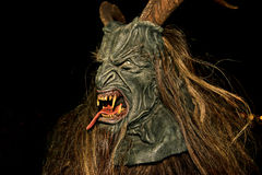 Perchten - Devil. Devil running with devil mask stock photography