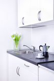 Percolator and cup of coffee on worktop, kitchen interior Stock Photography