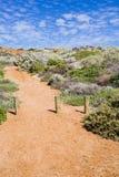 Percorso australiano della ghiaia della costa alla spiaggia Fotografia Stock Libera da Diritti