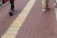 Percorso di pavimentazione tattile all'aperto del piede per Hong Kong cieco fotografie stock libere da diritti
