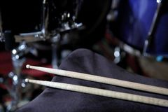 Drumsticks are an essential element that allows you to get the right sound from the drum kit. Percussion is the basic component of music used to give rhythm to stock image