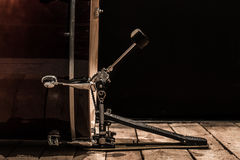 Percussion instrument, bass drum with pedal on wooden boards with a black background. The music concept Stock Photo