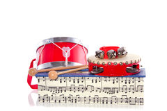 Percussion instruments. On a box of music notes isolated on white background royalty free stock photography