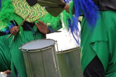 Carnival percussion. Percussion instruments feathers and carnival embroidery Royalty Free Stock Photo