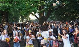 Percussion performance during the Karneval der Kulturen 2018, Berlin. Berlin, Germany - May 19, 2018: Crowd of people dancing and enjoying a percussion royalty free stock image