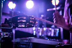 Percussionist hitting the tambourine. On the concert stage Royalty Free Stock Photography