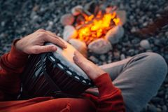 Percussionist playing djembe sitting by fire, close-up. Percussionist playing djembe sitting by the fire, close-up royalty free stock photo