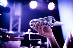 Percussionist shaking the music shaker Royalty Free Stock Photography