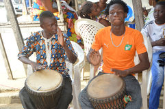 Percussionists. Ivory coast, abidjan february 26, 2015, these young drumers are showing their talent of big percussionists in a ceremony Royalty Free Stock Photography