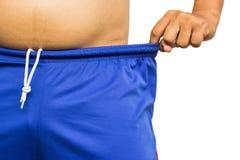 Perda de peso, homem que veste calças demasiado grandes Fotografia de Stock Royalty Free