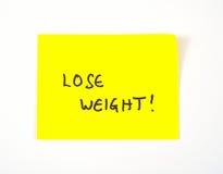 'Perda il peso' scritto su una nota appiccicosa Immagini Stock