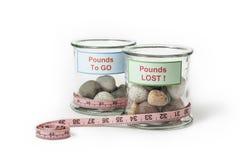 Perdita di peso che dimagrisce i barattoli Fotografia Stock Libera da Diritti