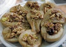 Pere con il dessert delle noci Immagini Stock