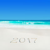 Perect white sand ocean beach and year 2017 season caption Royalty Free Stock Photos