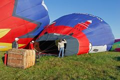 Crew of a hot air ballon preparing before flight at the festival of aeronautics in Pereslavl-Zalessky. Pereslavl-Zalessky, Russia - September 23, 2017: Crew of a stock photos
