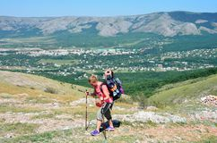 Perevalnoye, Crimea, July, 15, 2016. Woman comes with a backpack on flat land along the Eastern cliffs of the lower plateau of Cha. Tyr-Dag in Crimea royalty free stock photo