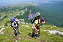 Perevalnoye, Crimea, Russia, July, 15, 2016. Tourists hiking on the upper plateau Chatyr-Dag to the top Eklizi-Burun 1527 m Royalty Free Stock Photography