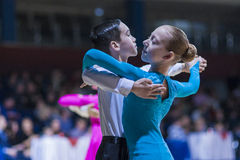 Pereverzev Marat and Ratomskaya Anna perform Juvenile-1 Standard European program Stock Images