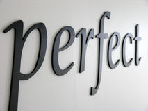 Perfect. Embossed letters forming the word perfect. Denim texture when viewed at full Stock Photography