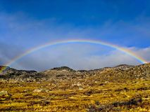 Perfect rainbow in the Anza Borrego Desert. A perfect arc rainbow on St. Patrick`s Day in the Anza Borrego Desert in Southern California royalty free stock photography