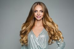 Perfect attractive woman with thick smooth hair in silver festiv