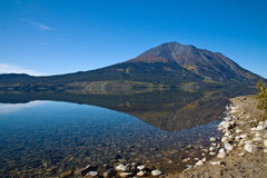 Perfect autumn reflection, Atlin Lake Stock Images