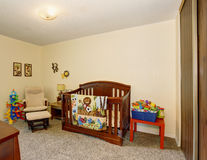 Perfect baby room with excellent wooden crib. Royalty Free Stock Photography