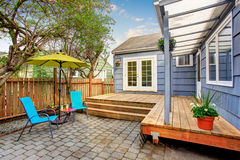 Perfect back deck with concrete patio and chairs. Royalty Free Stock Photos